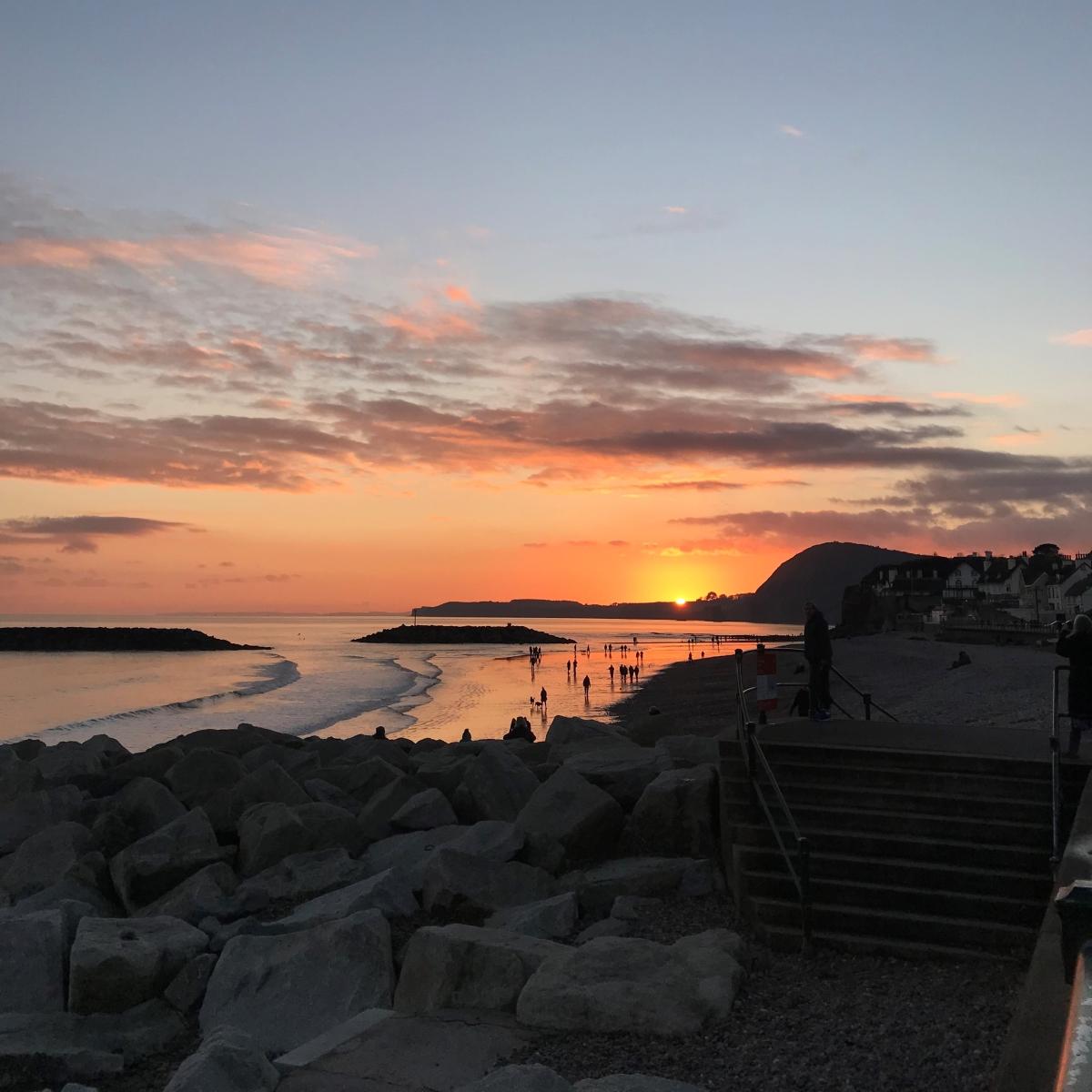 sidmouth beach, devon at sunset